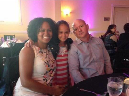 Cherise, Scott, and their daughter enjoying dinner at a restaraunt