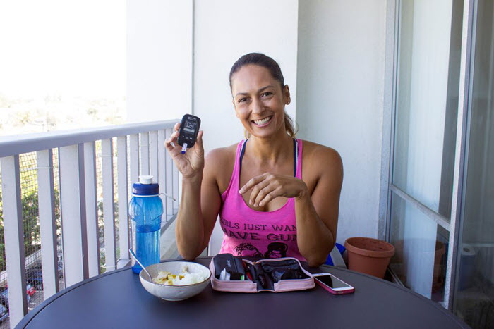 Christel Oerum of Diabetes Strong shows blood glucose result on Accu-Chek Aviva Connect meter while eating meal