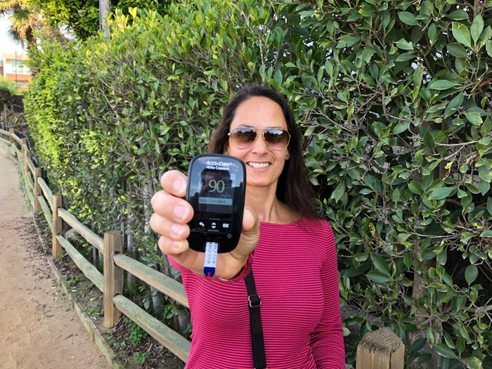 Christel Oerum of Diabetes Strong shows blood glucose result on Accu-Chek Aviva Connect meter