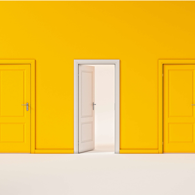One white door opens amid a uniformly yellow wall lined with yellow doors