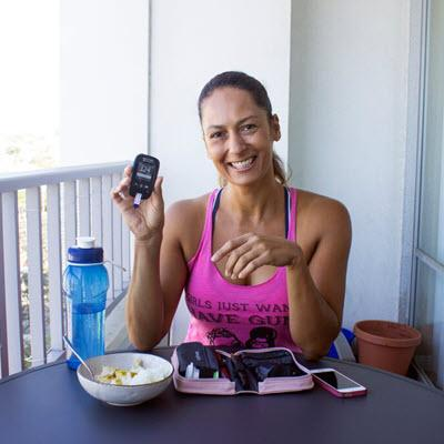 Christel Oerum of DiabetesStrong shows blood glucose result on Accu-Chek Aviva Connect meter while eating meal