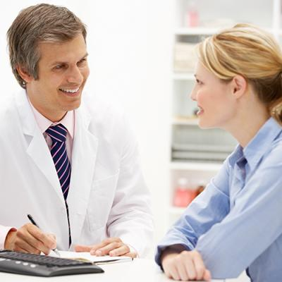 Male physician discusses treatment options with female patient