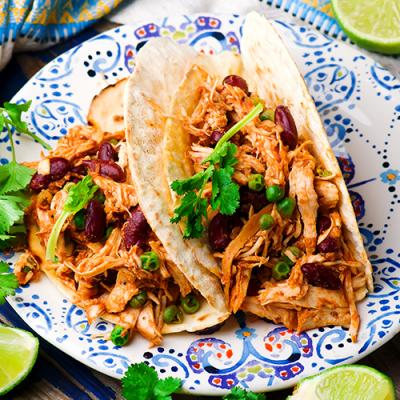 Chicken tacos with beans and garnish